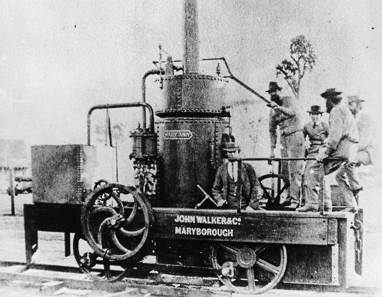 """Mary Ann – a very simple tank engine that spent its working life in a thick forest, ended its days in a locked shed in the village of Dundathu in Queensland and yet had a huge impact on today's Queensland railways. The Mary Ann was built in 1873 by the company that was to become Walkers Engineering of Maryborough. Over the years Walkers built many steam and diesel locomotives that were used across Australia. This loco was built for William Pettigrew for use on his 3' 3"""" gauge timber railway near Tin Can Bay in Queensland. Pettigrew and his inexpensive construction methods influenced the construction methods used by the Queensland Railways well into the 20th Century. (Photo from the State Library of Queensland)"""